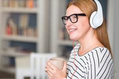 Positive woman listening to music Royalty Free Stock Photos