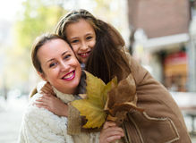 Positive woman with little girl Royalty Free Stock Image