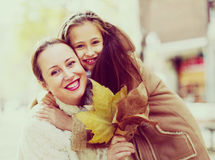 Positive woman with little girl Stock Photos