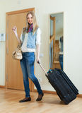 Positive woman with luggage. In home going on holiday Stock Image