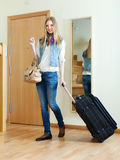 Positive woman with luggage  in home Stock Images