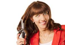 Positive woman makes a hair Stock Photos