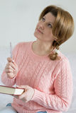 Positive woman with a notebook and pen in hand Stock Photography