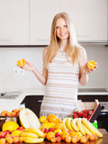 Positive  woman with  oranges and other fruits Stock Photo