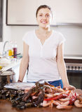 Positive woman with raw sea food Stock Photos
