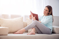 Positive woman reading book Royalty Free Stock Images