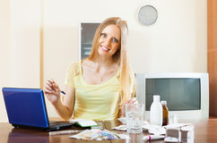 Positive woman reading about medications on the Internet Royalty Free Stock Image
