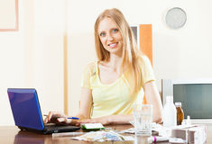 Positive woman reading about medicines on  Internet Royalty Free Stock Photo