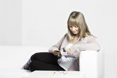 Positive woman reading Royalty Free Stock Photos