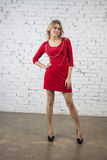 Positive woman in red party dress Royalty Free Stock Images