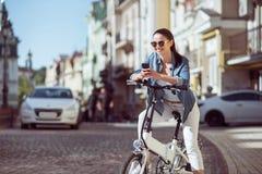 Positive woman riding a bicycle Stock Photos