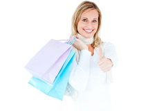 Positive woman with shopping bags and thumb up Royalty Free Stock Image