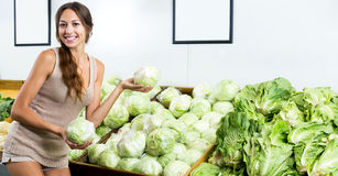 Positive woman shopping fresh green lettuce royalty free stock photography
