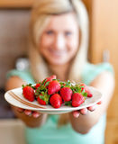 Positive woman showing fruits Stock Photos