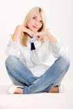 Positive woman sitting Stock Image