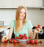 Positive  woman with  strawberries Royalty Free Stock Photography