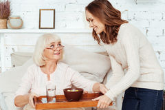 Positive woman takign care of her ill grandmother Royalty Free Stock Image