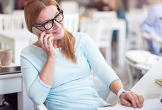 Positive woman talking on cell phone Stock Images