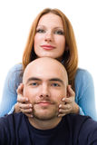 Positive woman touching men's head Royalty Free Stock Photos