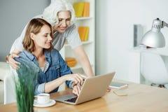 Positive woman using laptop Stock Photo