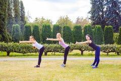 Positive women doing sport exercises. Stock Images