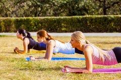 Positive women doing sport exercises. Stock Photos