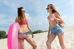 Positive women standing on the beach Royalty Free Stock Photos