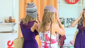 Positive women wearing hat looking at the mirror stock footage