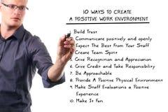 Positive work environment. Ten ways to create a positive work environment Stock Image