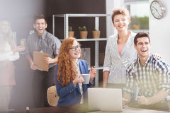 Positive work environment. Happy business team and positive work environment royalty free stock image