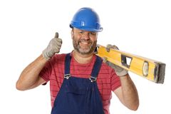 Positive Work Ethic. A happy worker giving a thumbs up to the camera, isolated on white royalty free stock images