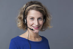 Positive young blond call center operative Stock Images