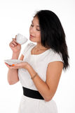 Positive young brunette woman with cup of coffee Stock Photography