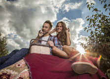 Positive young couple spending time outdoors. Royalty Free Stock Image