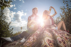 Positive young couple spending time outdoors. Royalty Free Stock Photography