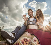 Positive young couple spending time outdoors. Royalty Free Stock Images