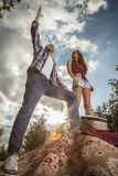 Positive young couple spending time outdoors. Royalty Free Stock Photos