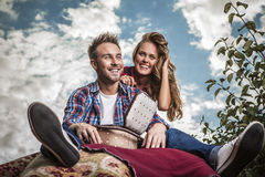 Positive young couple spending time outdoors. Stock Image