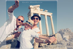 Positive young family take a sammer vacation selfie photo on ant Stock Photos