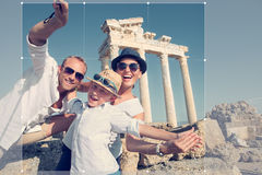 Positive young family take a sammer vacation selfie photo on ant. Ique sights view Stock Photography
