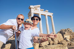 Positive young family take a selfie photo near antique сolonnad Stock Photos