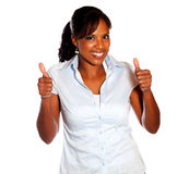 Positive young female lifting the fingers up Royalty Free Stock Image