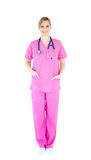Positive young female surgeon wearing scrubs Royalty Free Stock Photo