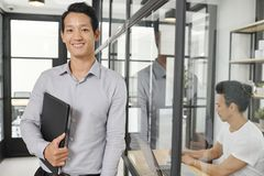Positive young financial manager stock images