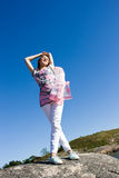 Positive young girl against the sky in summer Royalty Free Stock Photo