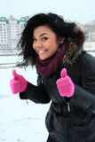 Positive young girl in pink gloves Royalty Free Stock Photo
