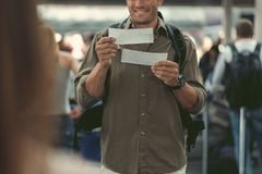 Positive young guy is waiting for flight Royalty Free Stock Photography