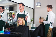 Positive young man cutting long hair of girl Royalty Free Stock Photography