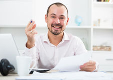 Positive young man in office Stock Images