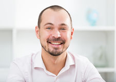 Positive young man in office Stock Photography